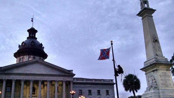 Bree Newsome (with support from local activists) scales the flag pole in front of South Carolina's courthouse in Charleston, and takes down the Confederate flag at dawn on June 27, 2015. She is immediately arrested. For updates follow ColorOfChange.org and @fergusonaction on Twitter. (Photo also needs a photographer credit: Please tag in comments)