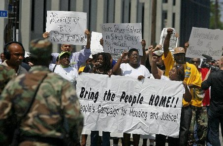 STAFF PHOTO BY TED JACKSON Protestors exit the offices of HUD in New Orleans after a 90 minute sit-in. Police responded by blocking off the area and negotiating with the group, Friday, August 31, 2007.